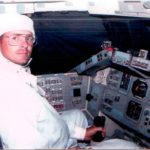 Early 1990's photo op in the cockpit of the Space Shuttle